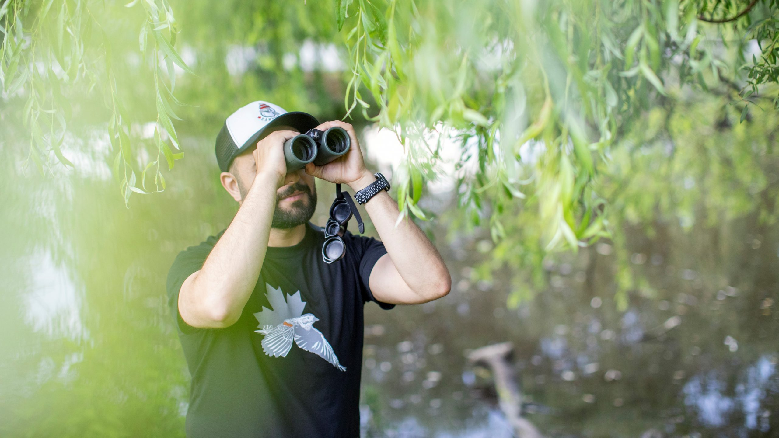 Yousif Attia out for a bird walk in Vancouver's Queen Elizabeth Park on June 24, 2021. Alia Youssef/The Globe and Mail.
